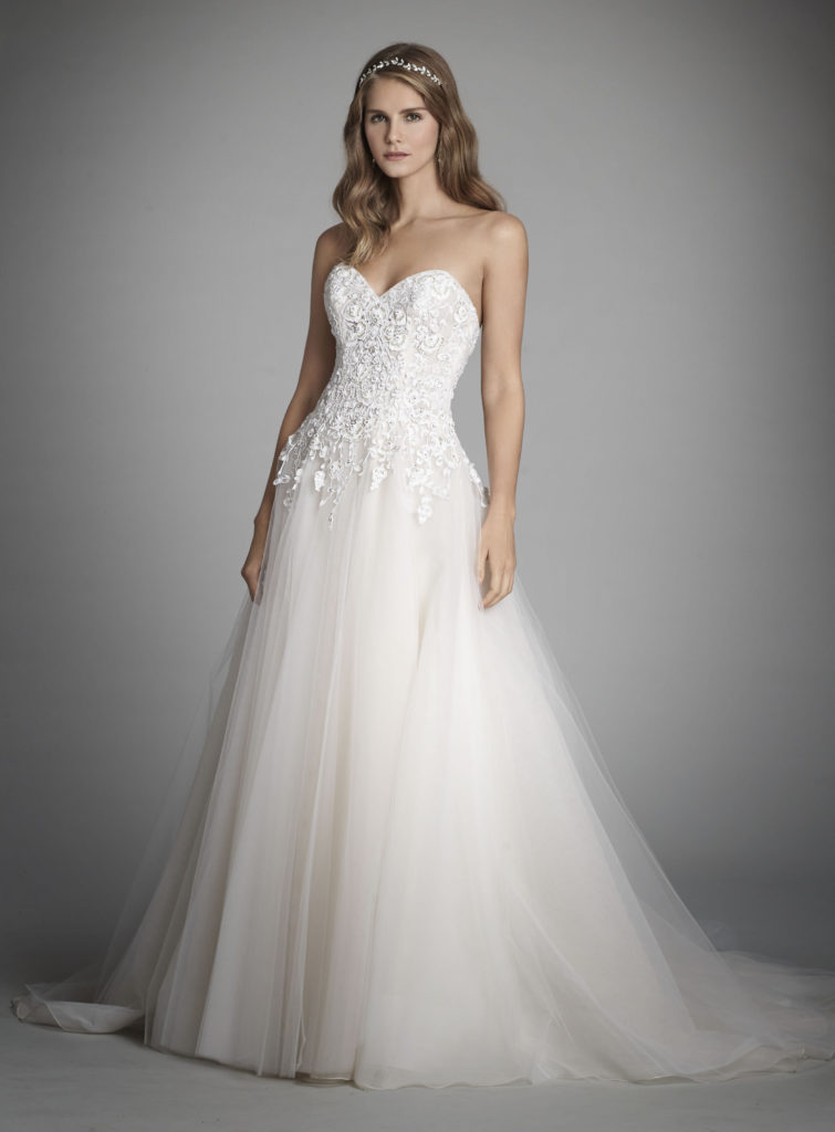 Petite bride in white, floor length Alvina Valenta wedding dress with lace applique, dropped waist and tulle skirt