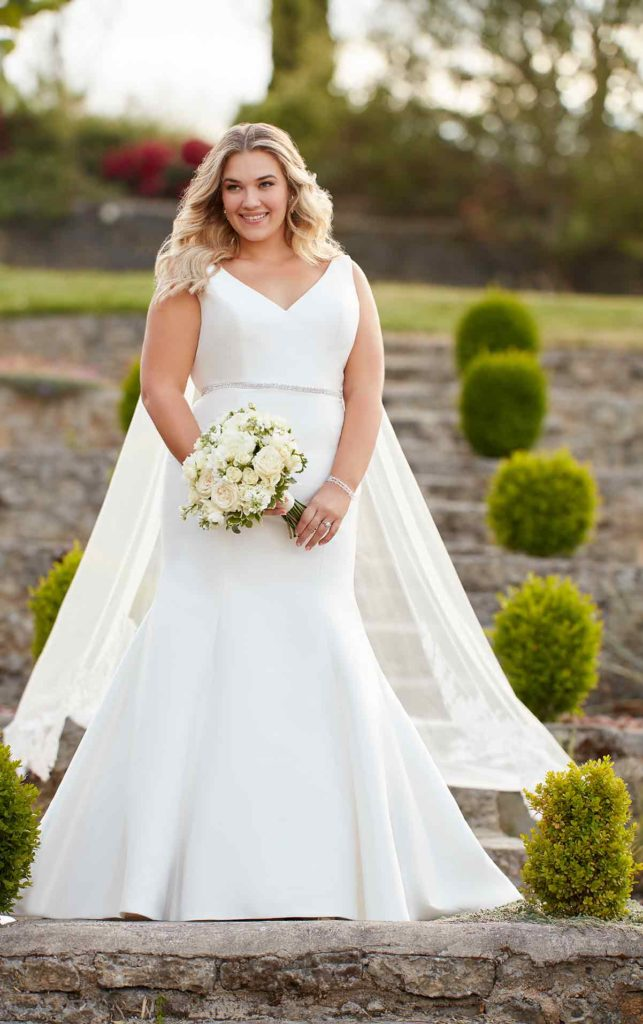 Plus size bride in white, fit and flair, floor length Essence of Australia wedding gown