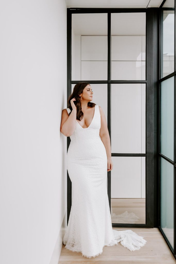 Plus-size bride in sleek, V neck, white wedding dress