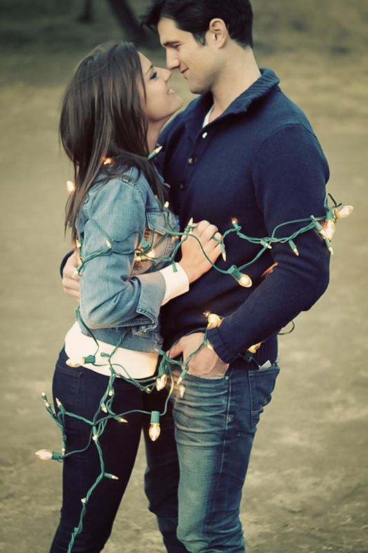Engagement photo with lights