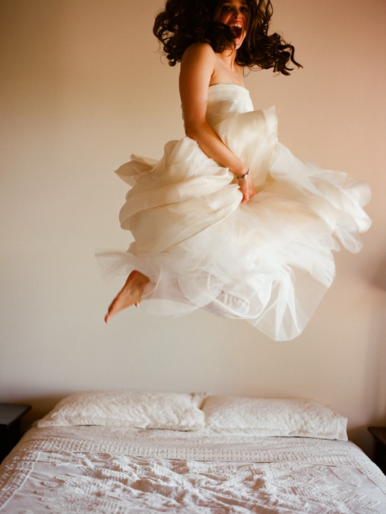 Bride jumping on bed, wedding night