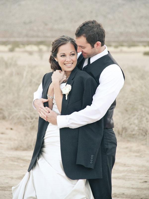 Groom hugging bride, jacket, insurance