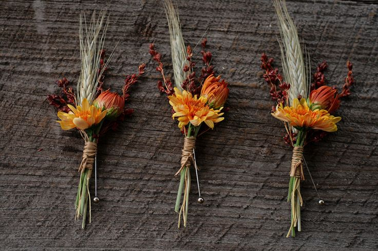 Three orange boutonnieres