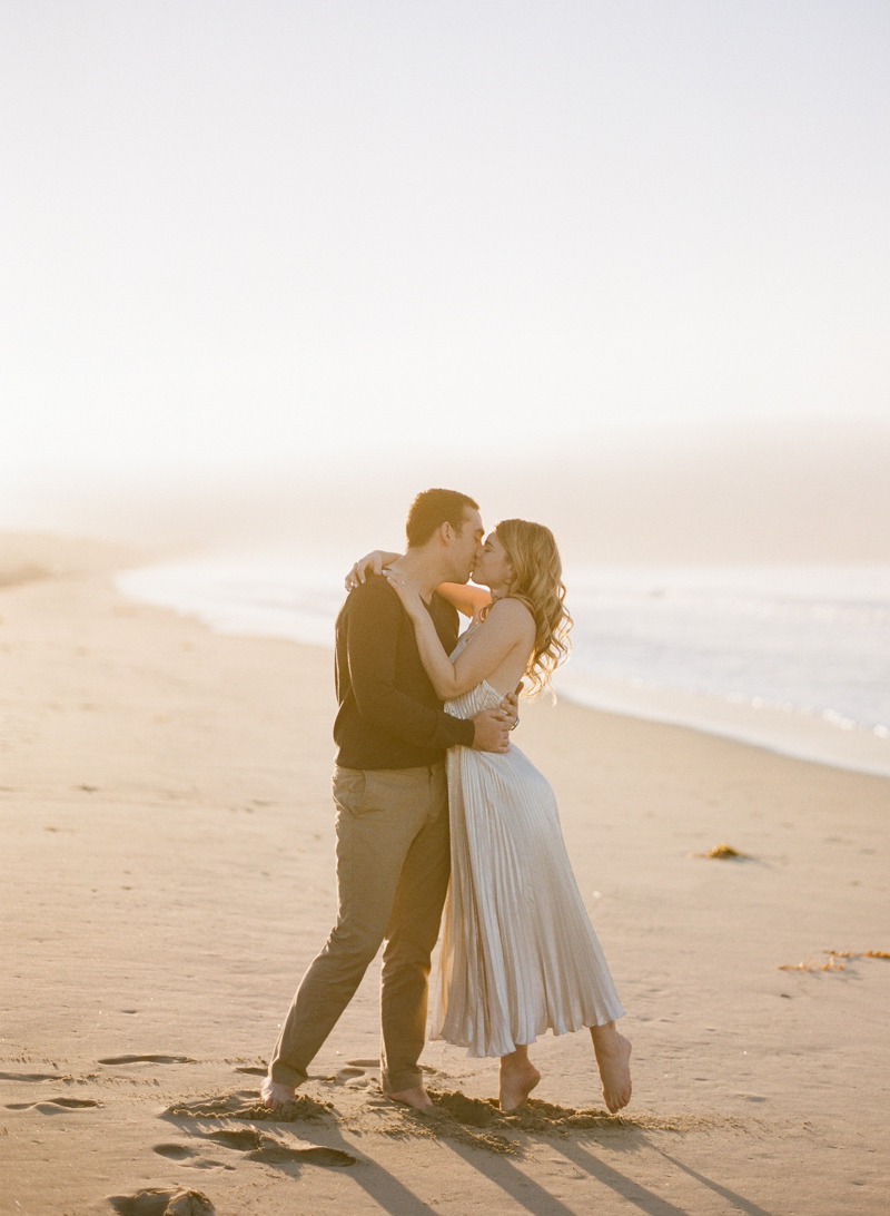 Bride and groom to be on the beach