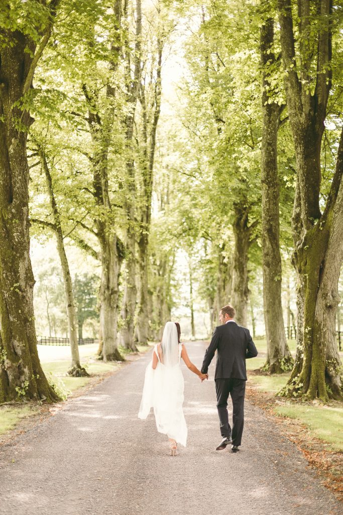 Tankardstown House: couple walking on grounds