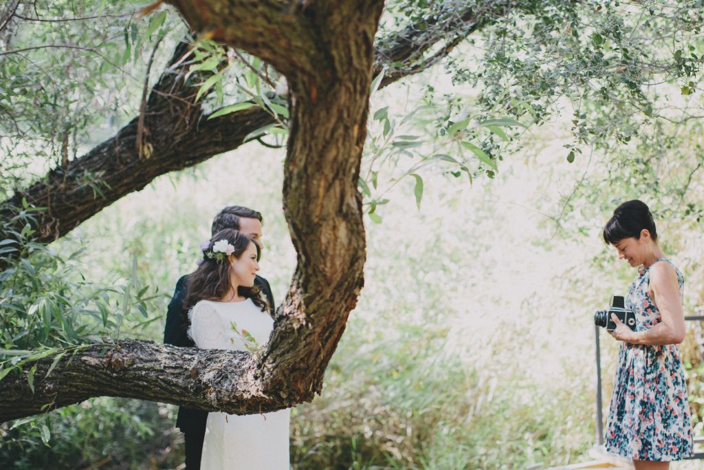 Bride and Groom outdoors under a tree. Photography idea. Nature.