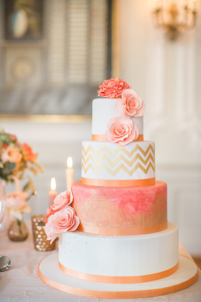 4 tier coral and white wedding cake