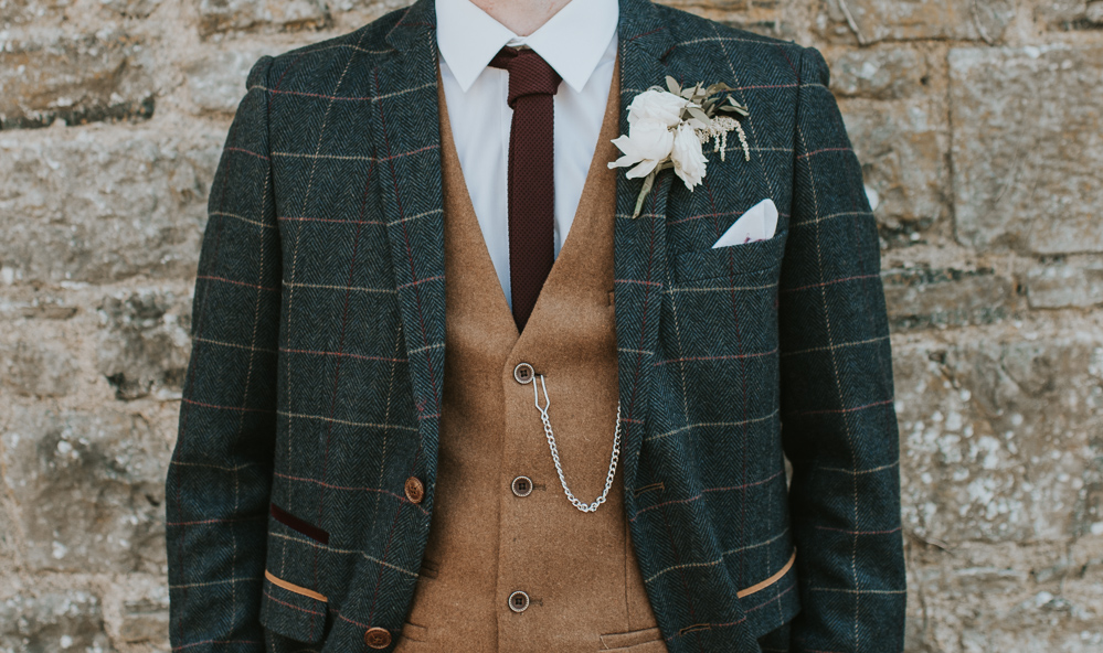 Green Tartan suit with camel waistcoat and ox blood tie photographed by Louise Scott Photography
