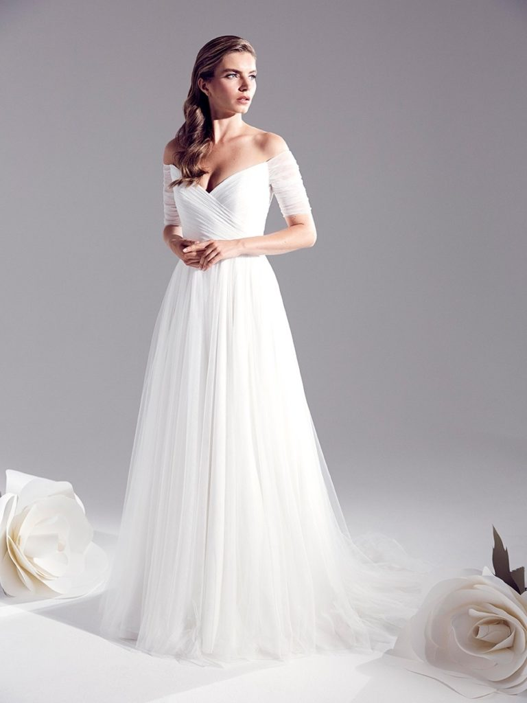 Off shoulder white, floor length A-line dress by Jenny Packham