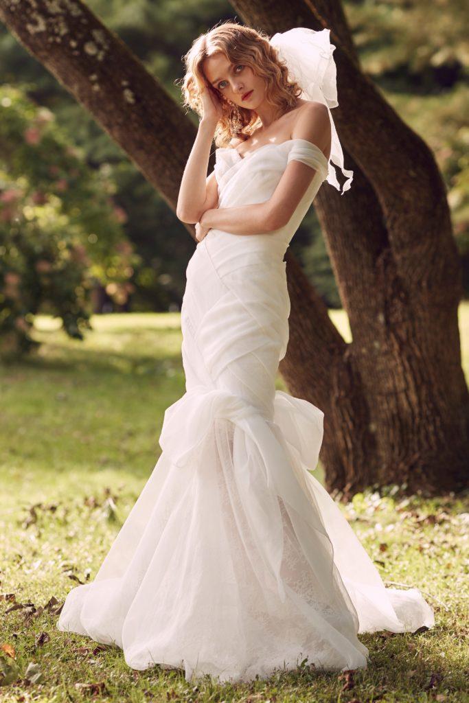 White, floor length, ruffled mermaid dress by the Marchesa