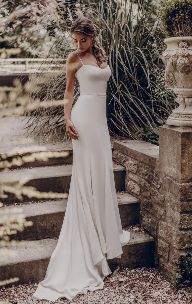 Sleek white, minimalist sheath dress by Stephanie Allin