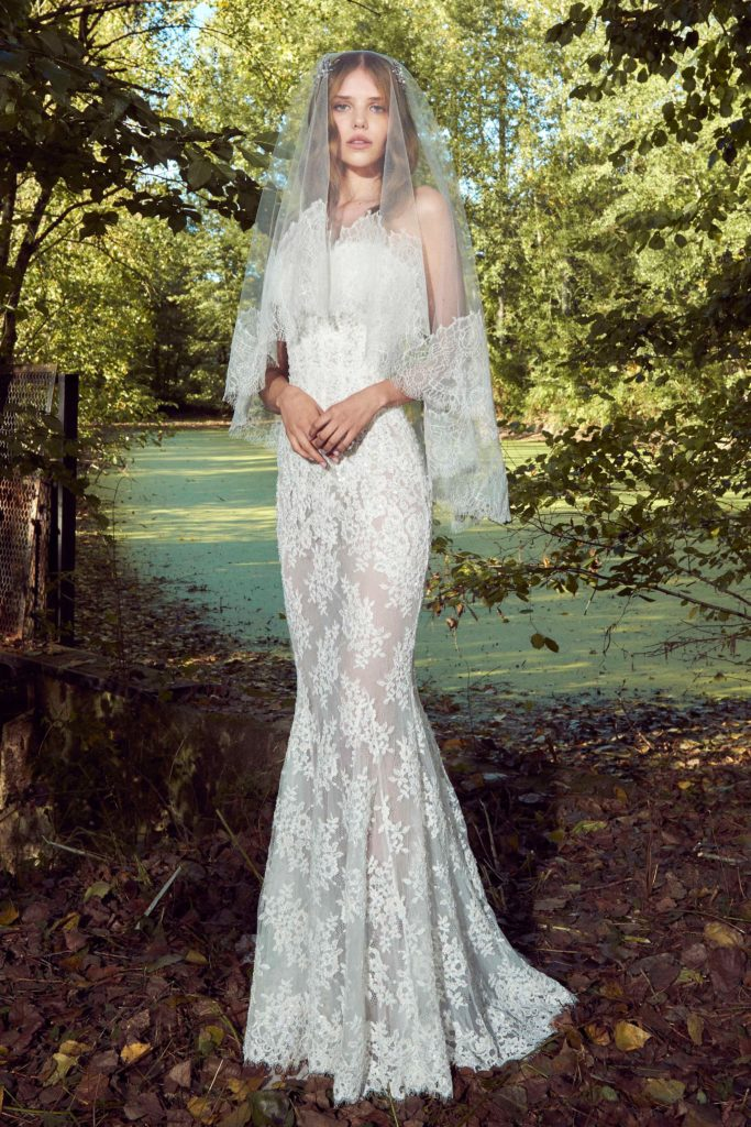 Fitted, semi sheer, white, floor length lace dress by Zuhair Murad