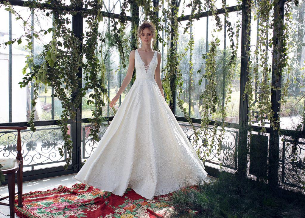 White, lace, plunge neckline floor-length dress by Limor Rosen