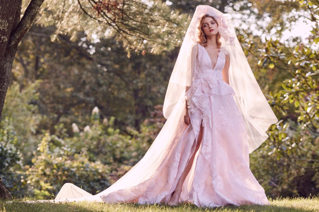 Floor length, sleeveless, powder pink dress, with right leg slit and plunge neckline by Marchesa