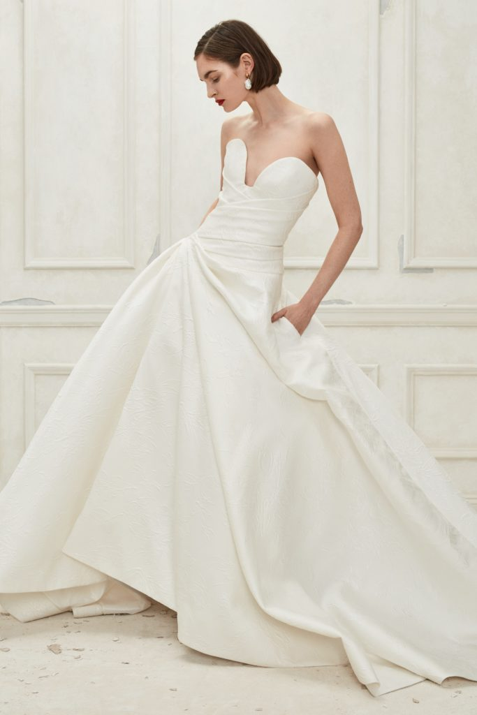 White, floor-length silk dress with deep sweetheart neckline, ruffled details and drop waist by Oscar de la Renta