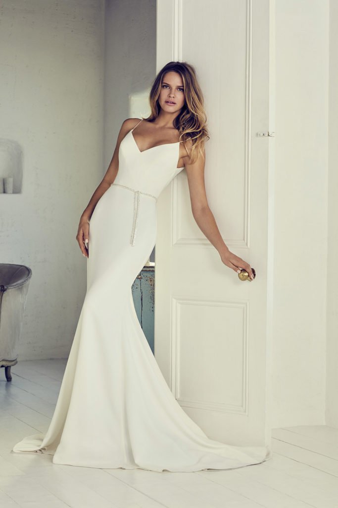 White, floor-length simplistic dress, bias-cut by Suzanne Neville
