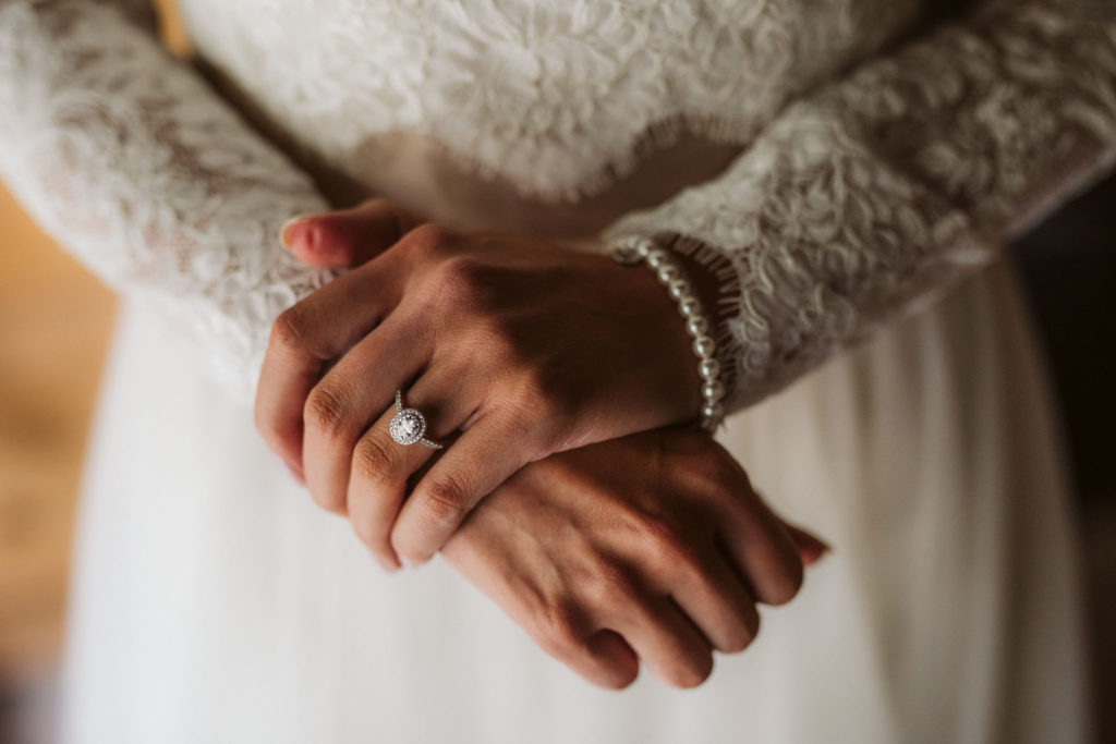 Real Wedding at Ballybeg House. Close up of brides hands. Vicible is a pear bracelet and her diamond engagement ring.