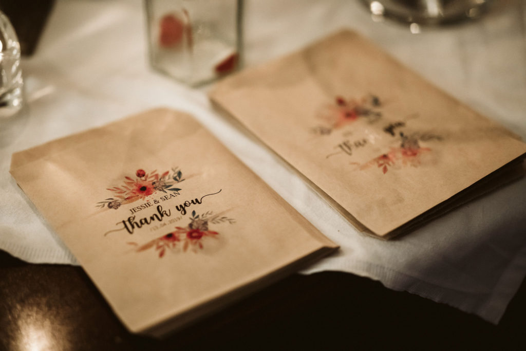 Real Wedding at Ballybeg House. Favour bags featuring the couples name and the text'Thank you'. There is a floral motif on the bags, the same floral motif that ran throughout the wedding.