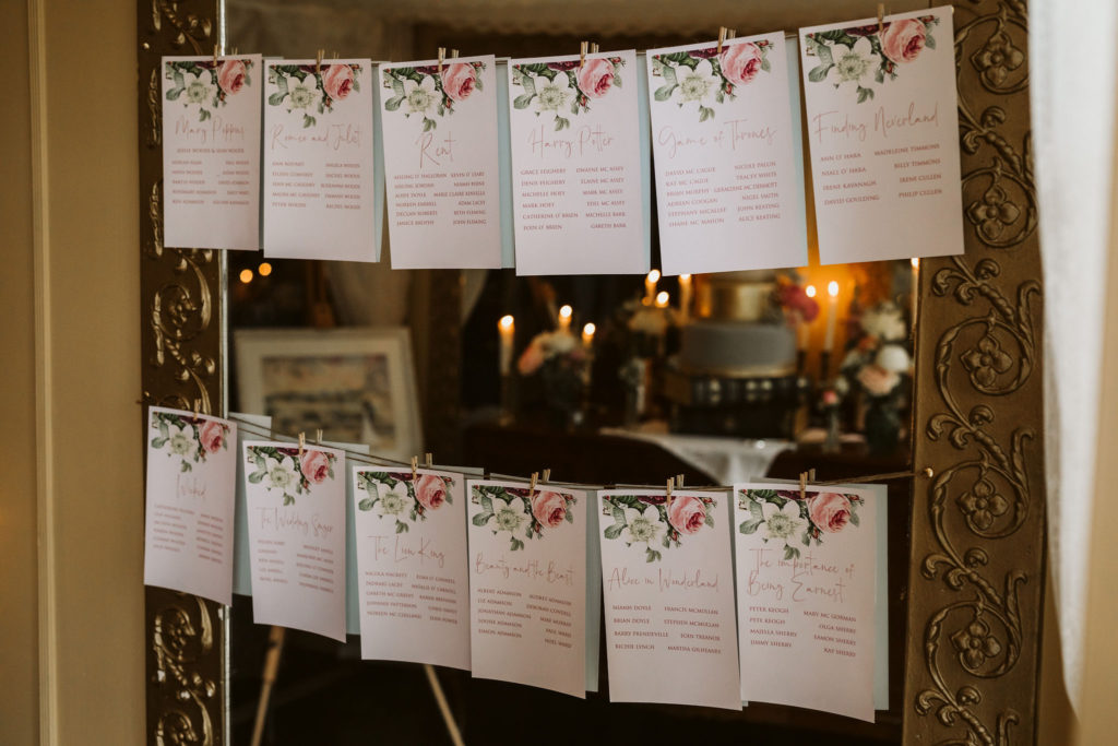 Real Wedding at Ballybeg House. Table seating plan, each card is hanging on a line, affixed using a peg.