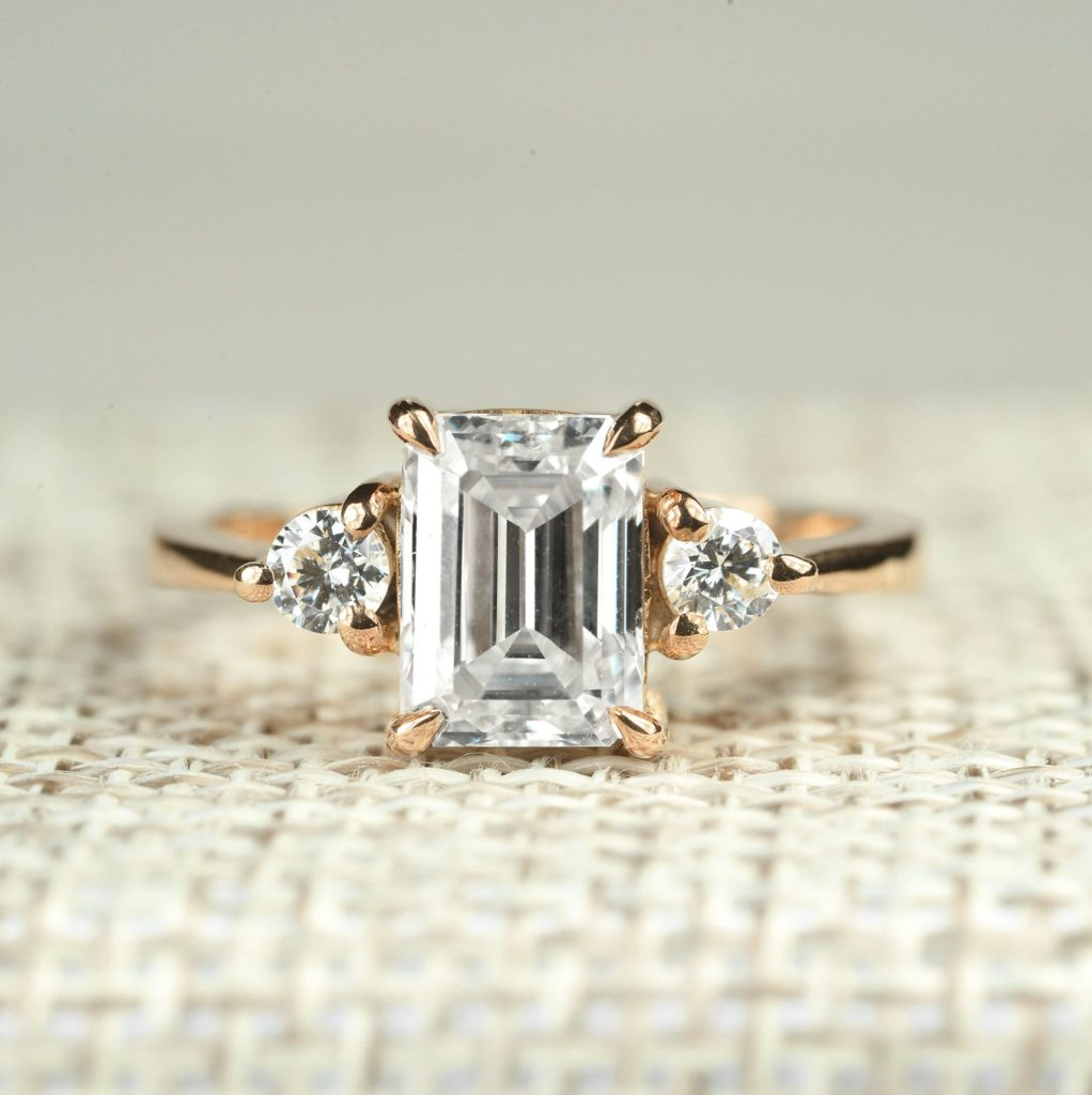 An elegant Art Deco design ring featuring an large Emerald cut Moissanite centrestone and Natural Diamond sidestones. Diorahjewelry Etsy 1,525.0An elegant Art Deco design ring featuring an large Emerald cut Moissanite centrestone and Natural Diamond sidestones. Diorahjewelry Etsy 1,525.0