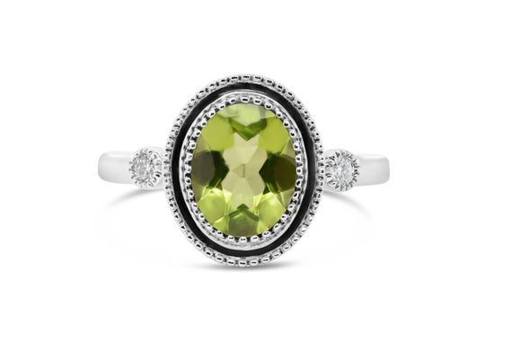 Peridot Engagement Ring, Carbn Co on Etsy