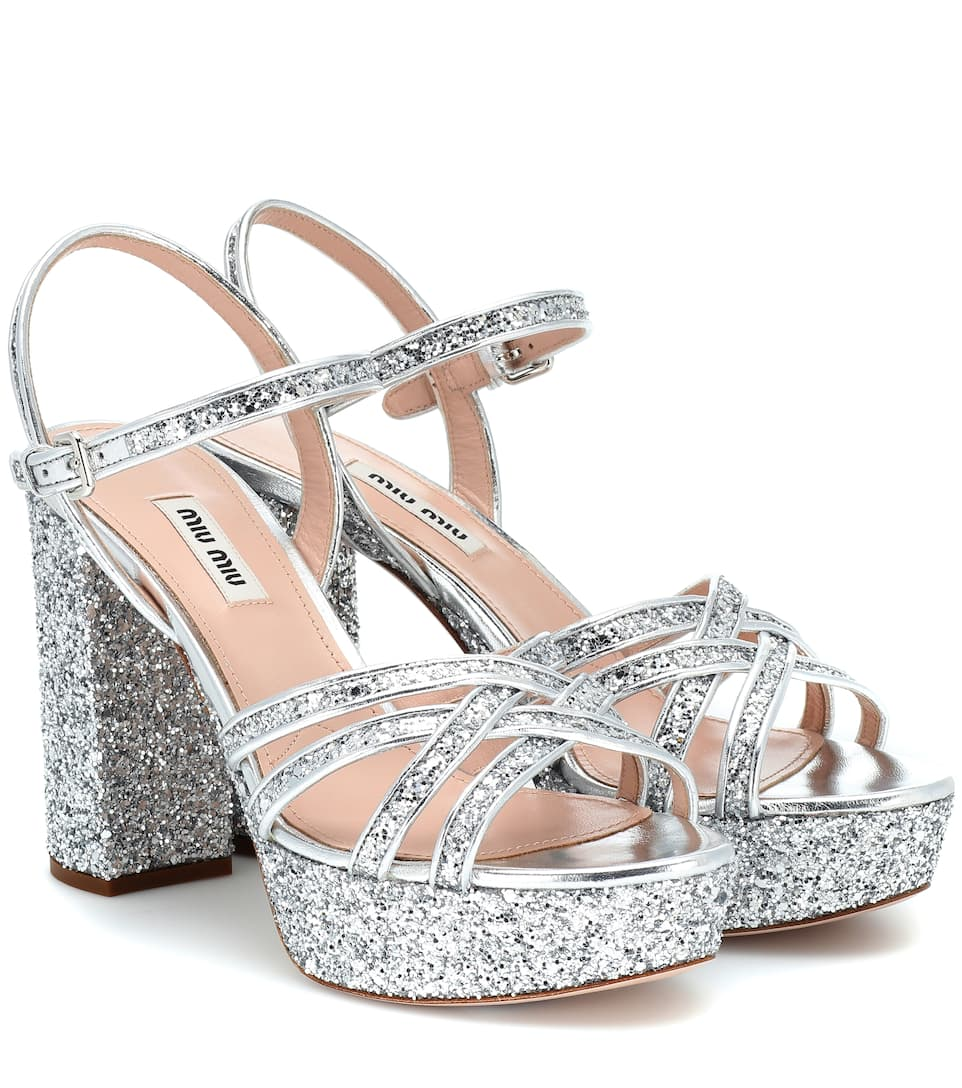 Miu Miu silver glitter platform chunky heeled sandals. They retail for €670