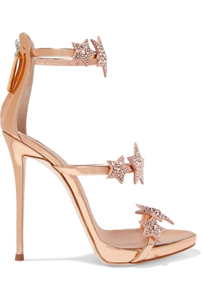 Giuseppe Zanotti Coline appliquéd rose gold metallic leather stiletto sandals with rose gold diamond stars across three straps on the foot. Retails for €470
