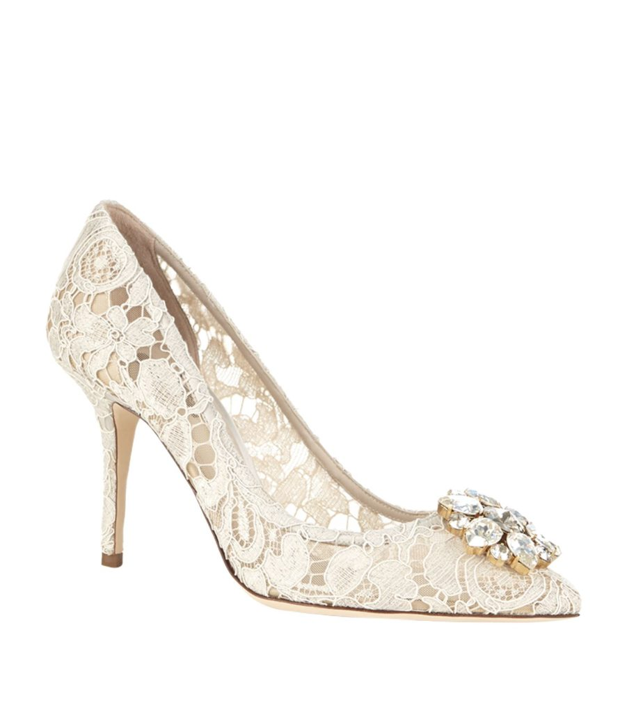 White Dolce & Gabbana Lace Rosa Embellished Pumps with large silver flower brooch attached to the toe. Retails for €743