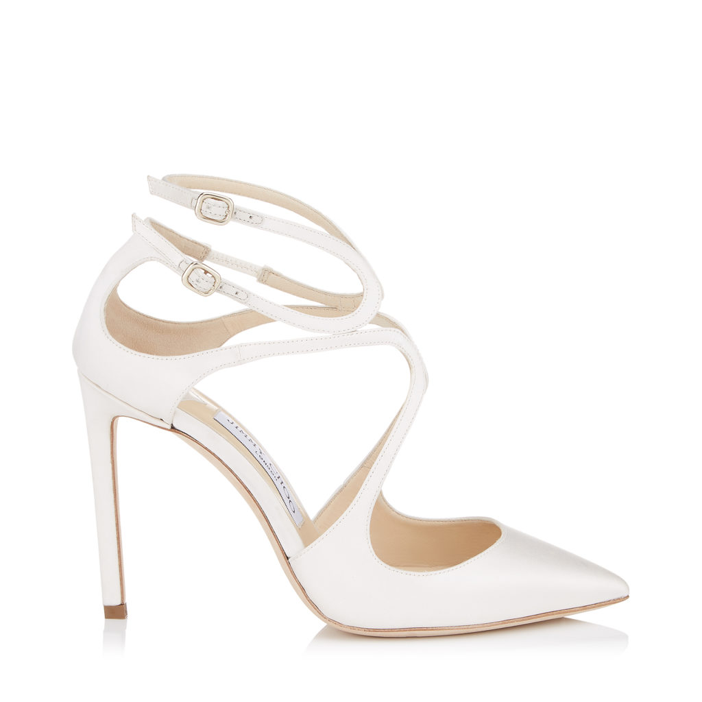 Jimmy Choo white Lancer 100 satin pumps, with twisted strap details from toe to ankle and two small buckles. Retails for €650