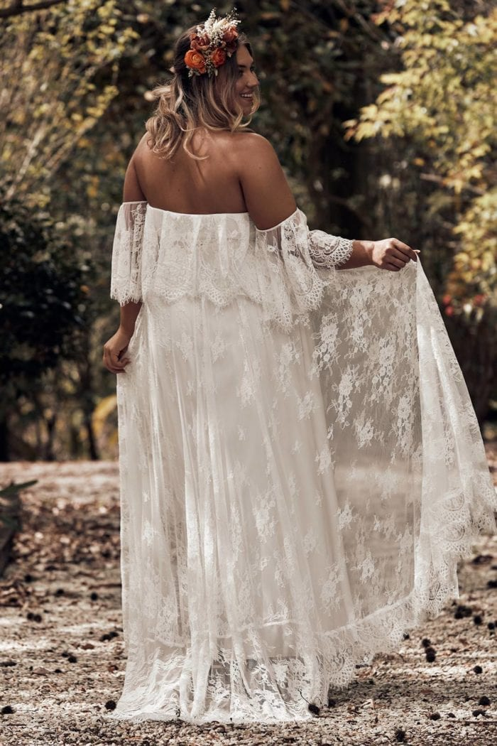 Curvy bride in floor length, off the shoulder, white, sheer lace gown with white satin under slip