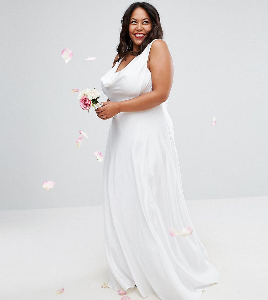 Plus size bride in white draping dress that flows over the body